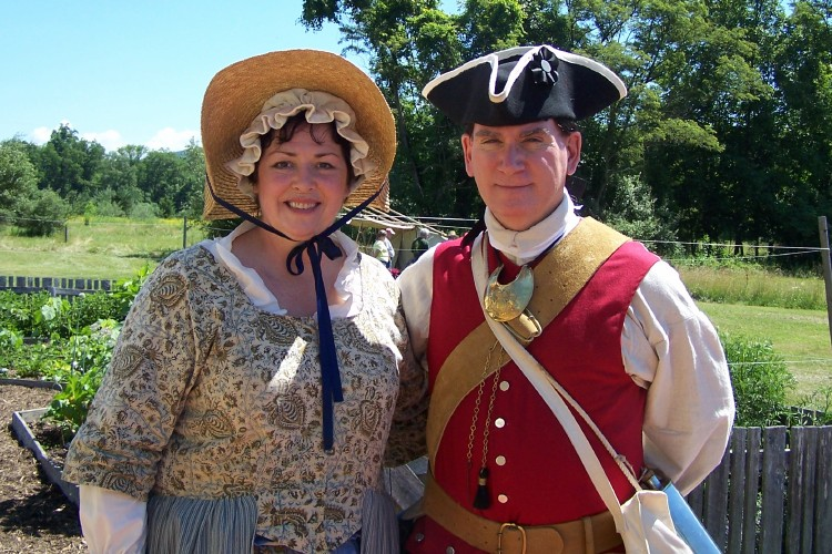 Two Reenactors Pose in Front the Fort's Colonial Garden