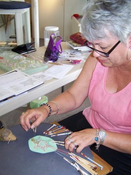 Judi making a lace ornament for Tamarack